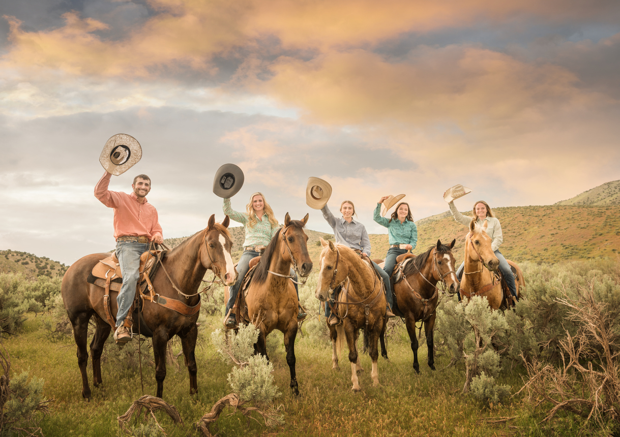 Cowfamily, father, daughters on horses, fields and Utah mountains